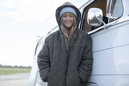 portrait happy young woman in hooded