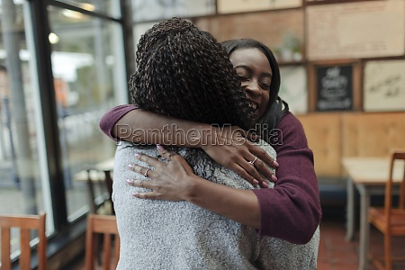 happy mother and daughter hugging in
