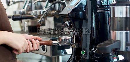 barista making fresh espresso coffee espresso