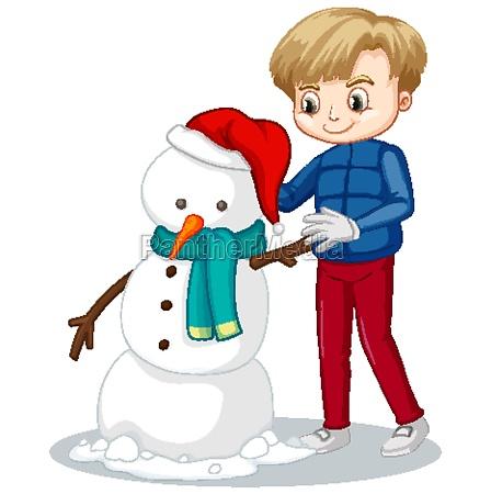 happy boy manking snowman on white