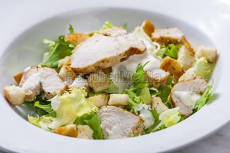 still life of caesar salad