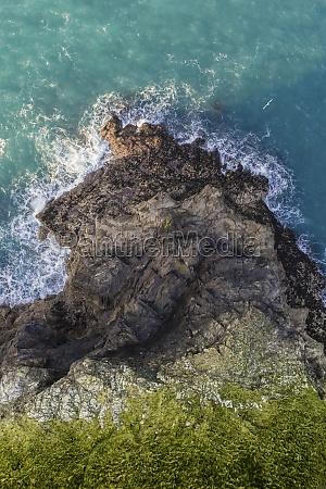 aerial view of waves breaking on