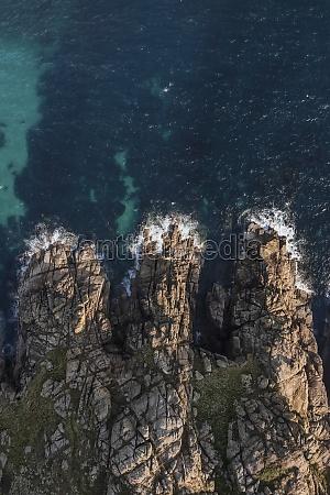 aerial view of waves breaking along