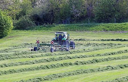 a farmer in bavaria is cutting