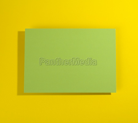 blank green sheet of paper on