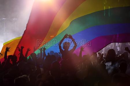 gay parade with lgbt flag