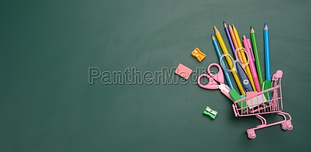 miniature shopping cart full of school