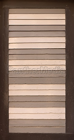 old shutter with slats painted in