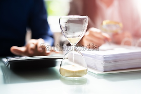 hourglass and time crunch with document