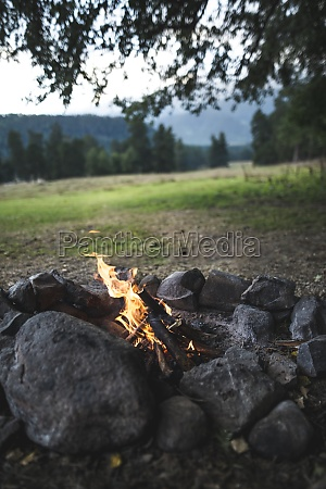 russia caucasus mountains bonfire under tree