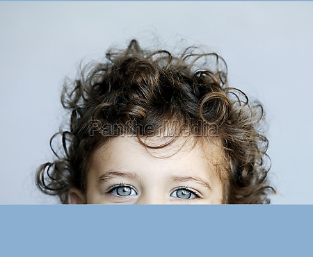 portrait of little girl behind desk