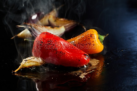 tasty peppers cooking on hot surface