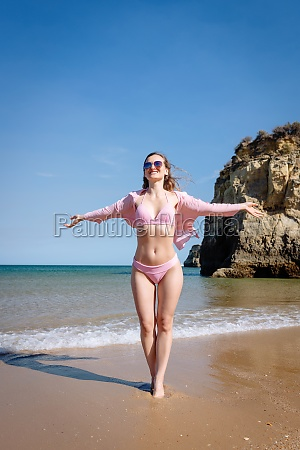 tourist woman enjoying the beach of