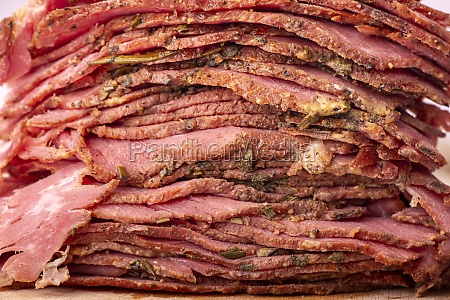 stack of sliced pastrami meat