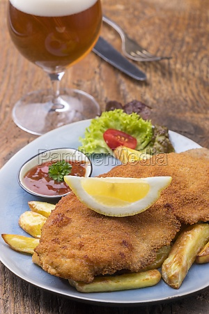 wiener schnitzel with fries on a