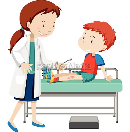 doctor helping young boy with sore
