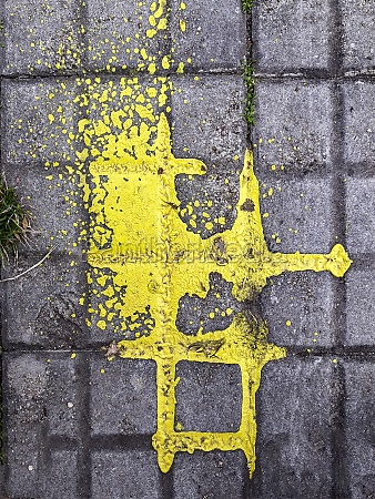 yellow paint over sidewalk top view