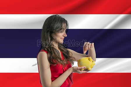economy in thailand accumulating and saving