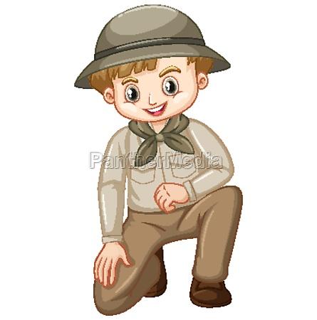 boy in scout uniform sitting on