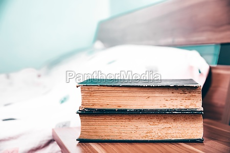 bedroom with books on nightstand