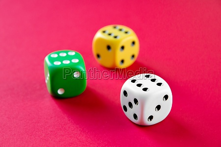 three colorful dices isolated on pink
