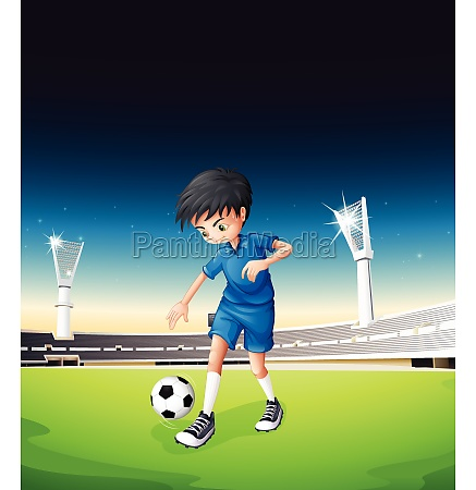 a soccer field with a boy
