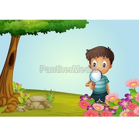 a boy with lense in garden