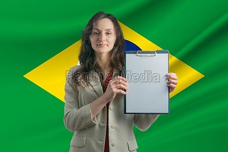study in brazil beautiful woman holding