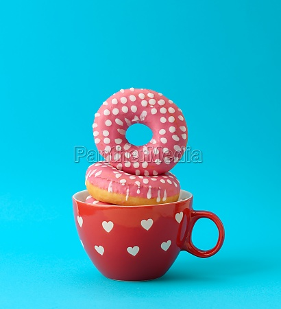 a stack of pink donuts with