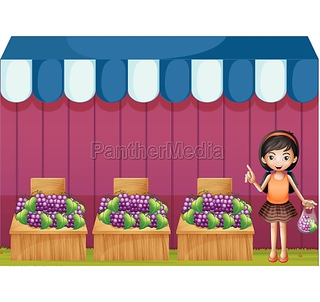 a girl selling grapes