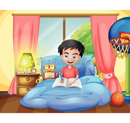 a boy writing on his bed