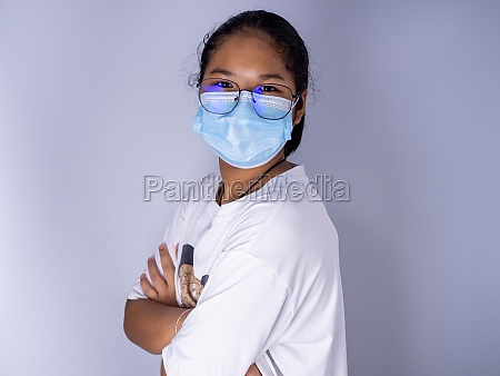 girl wearing a mask and wearing
