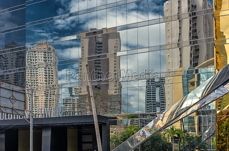 business skyscrapers in mirror reflection in