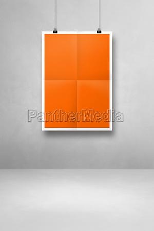 orange folded poster hanging on a