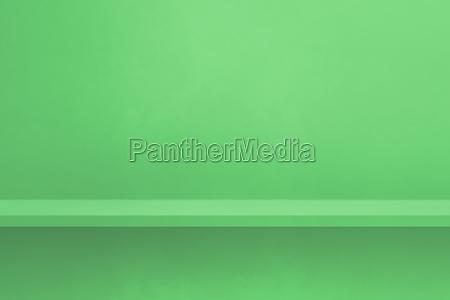 empty shelf on a green wall