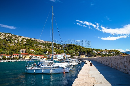 sailing harbor in baska waterfront view