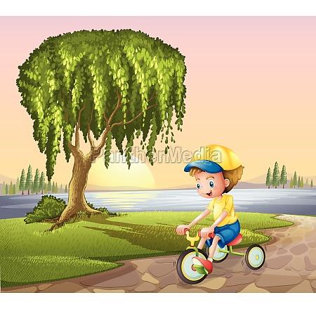 a little boy biking