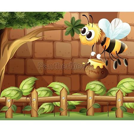 a bee holding a honey inside