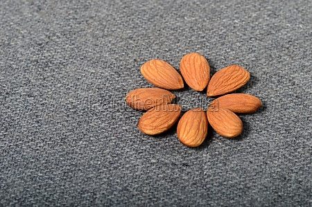 tasty almonds on gray background