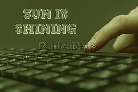 writing displaying text sun is shining