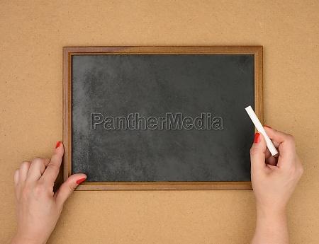 empty rectangular brown wooden frame on