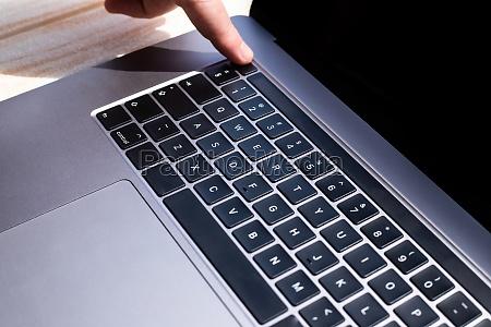 hands pointing pressing computer keyboard keys