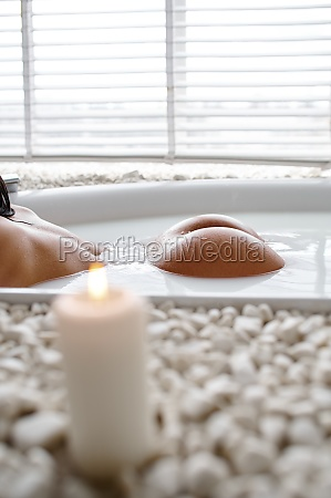 sexy woman in bath with milk
