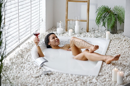 sexy woman with glass in bath