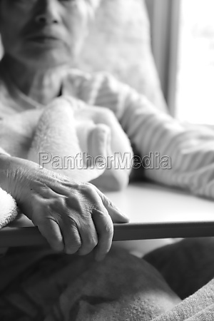 elderly woman with dementia holding on