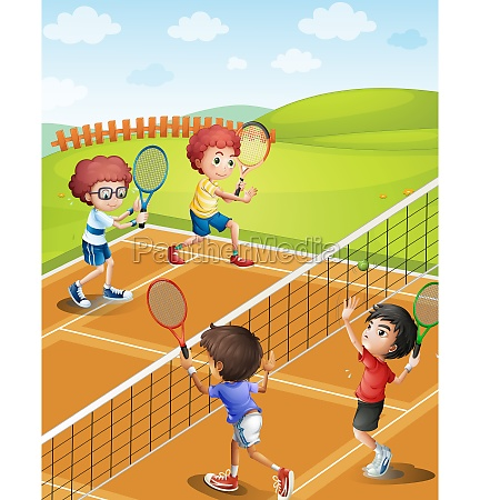children playing tennis at the court