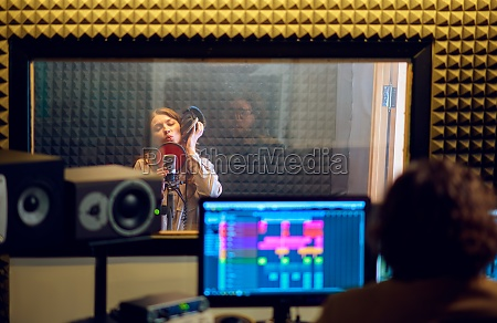 male musician and female singer recording
