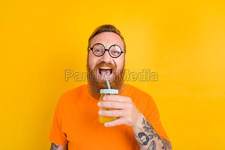 nerd happy man with glasses drinks