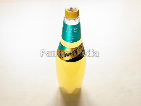 plastic bottle of schweppes bitter lemon