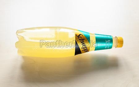 lying bottle of schweppes bitter lemon